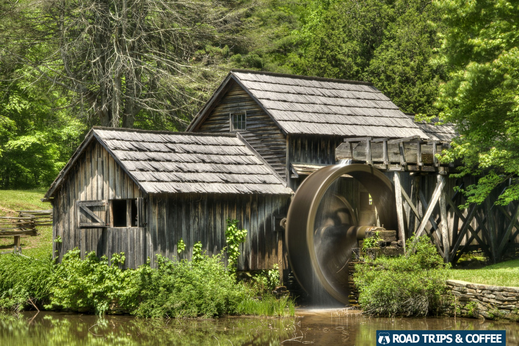 The spinning wheel of Mabry Mill on the edge of a pond along the Blue Ridge Parkway in Virginia