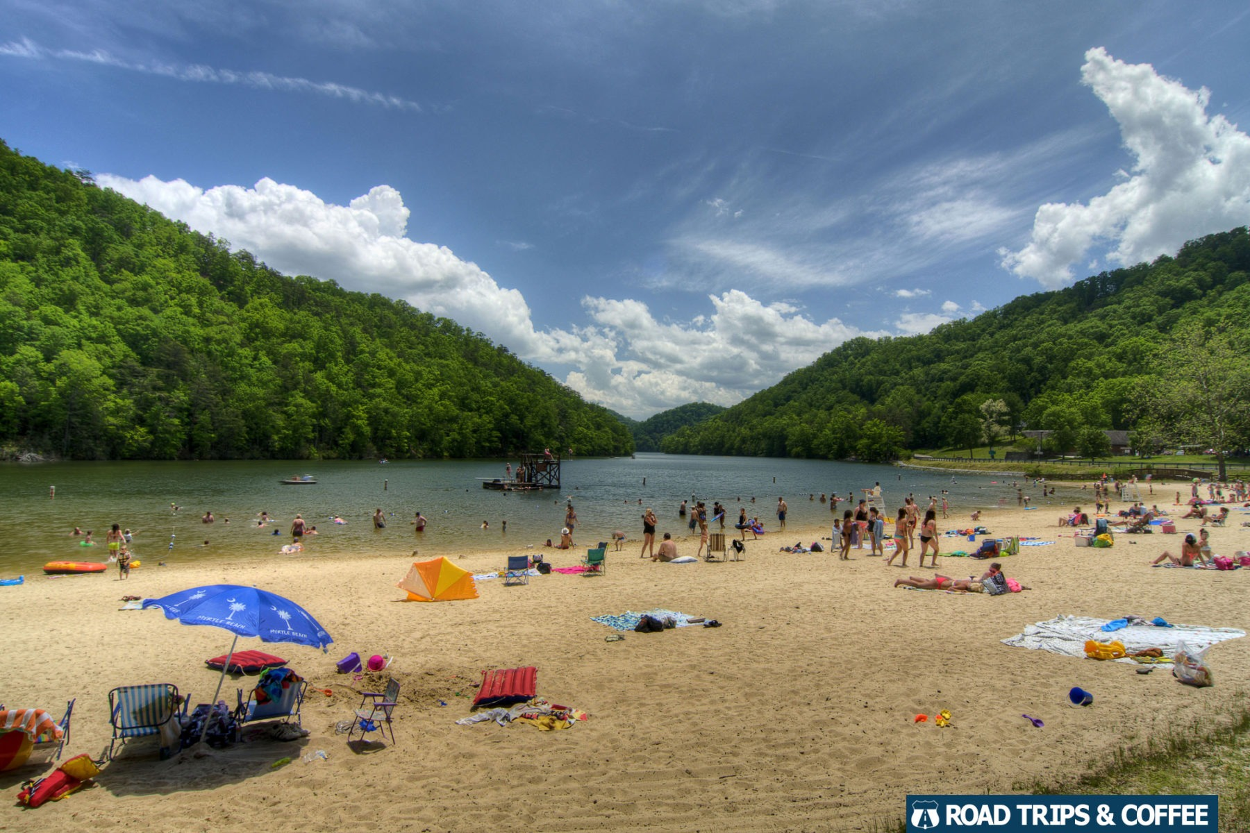 Large sandy beach on the shore of a lake surrounded by the mountains at Hungry Mother State Park in Marion, Virginia