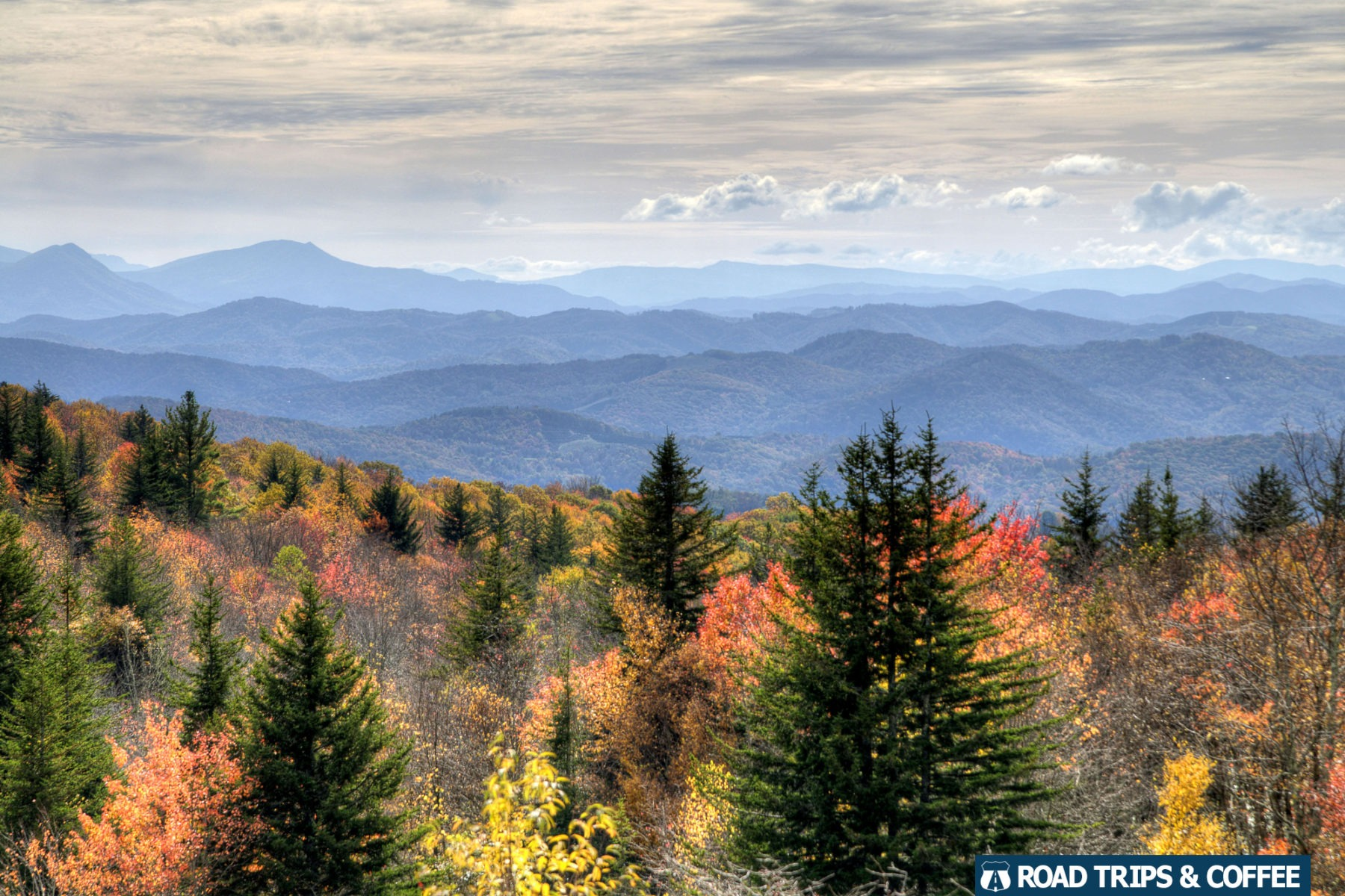 Fall colors with a wide mountain vista on the Massie Gap Trail at Grayson Highlands State Park in Virginia