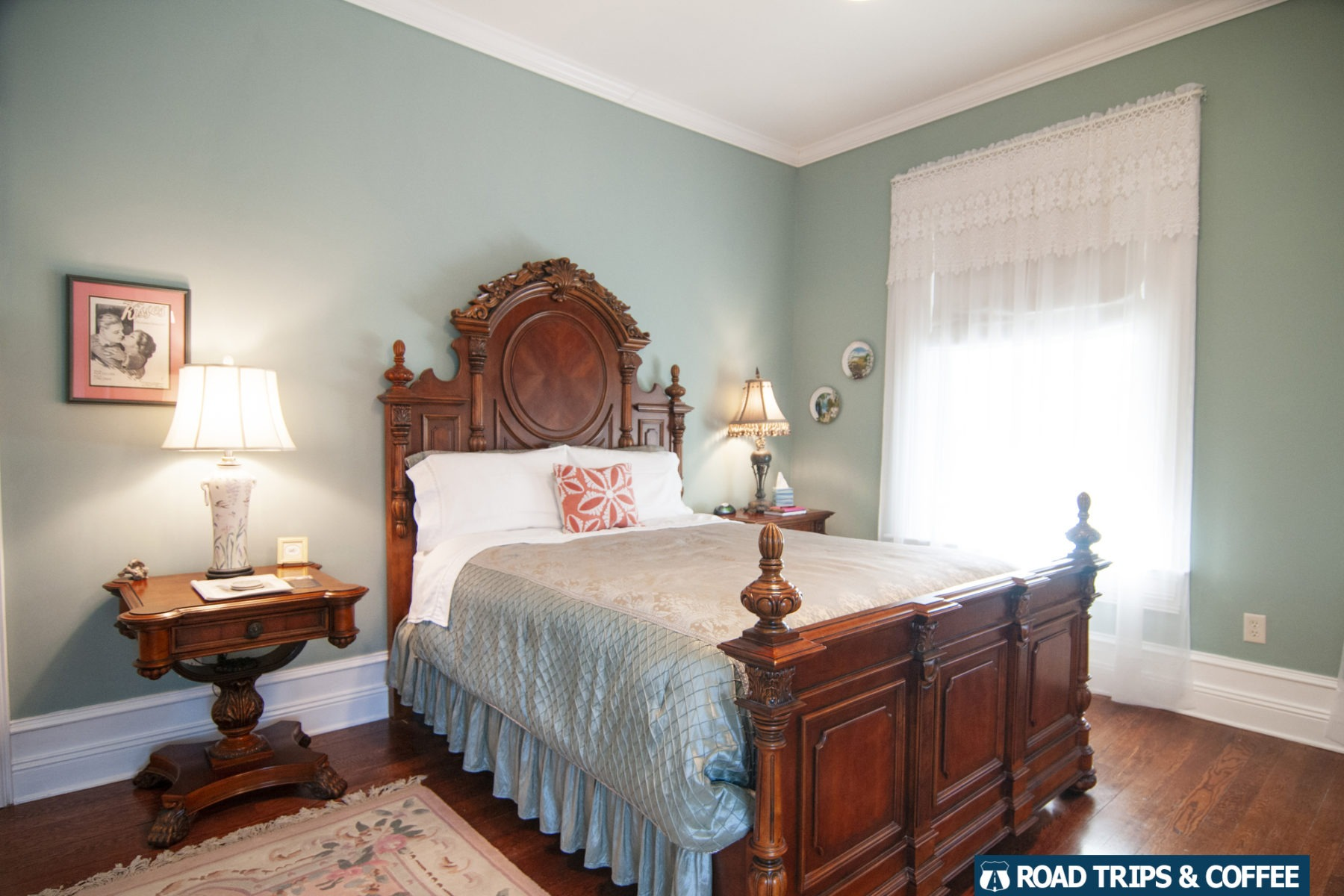 A comfortable bed in a large wooden bedframe in the Trinkle Mansion Bed and Breakfast in Wytheville, Virginia