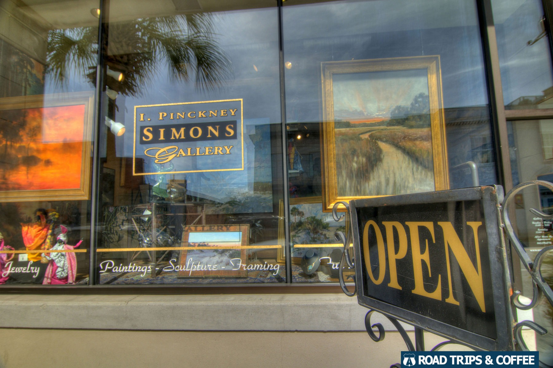 Artwork on display in large glass windows at the I. Pinckney Simons Gallery in Beaufort, South Carolina