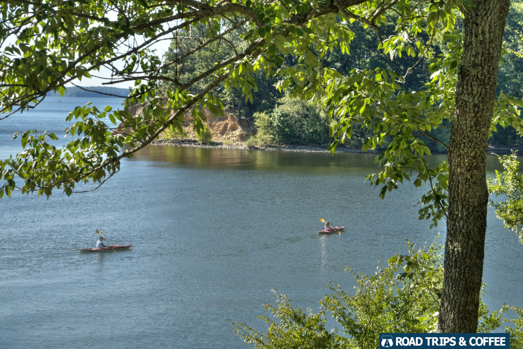 A pair of kayakers paddle across the deep blue Kentucky Lake at Land Between the Lakes National Recreation Area