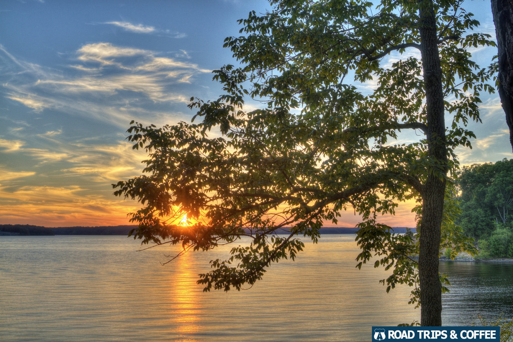 A warm sunset over Kentucky Lake seen from the campsite at the Redd Hollow Basic Campground at Land Between the Lakes National Recreation Area