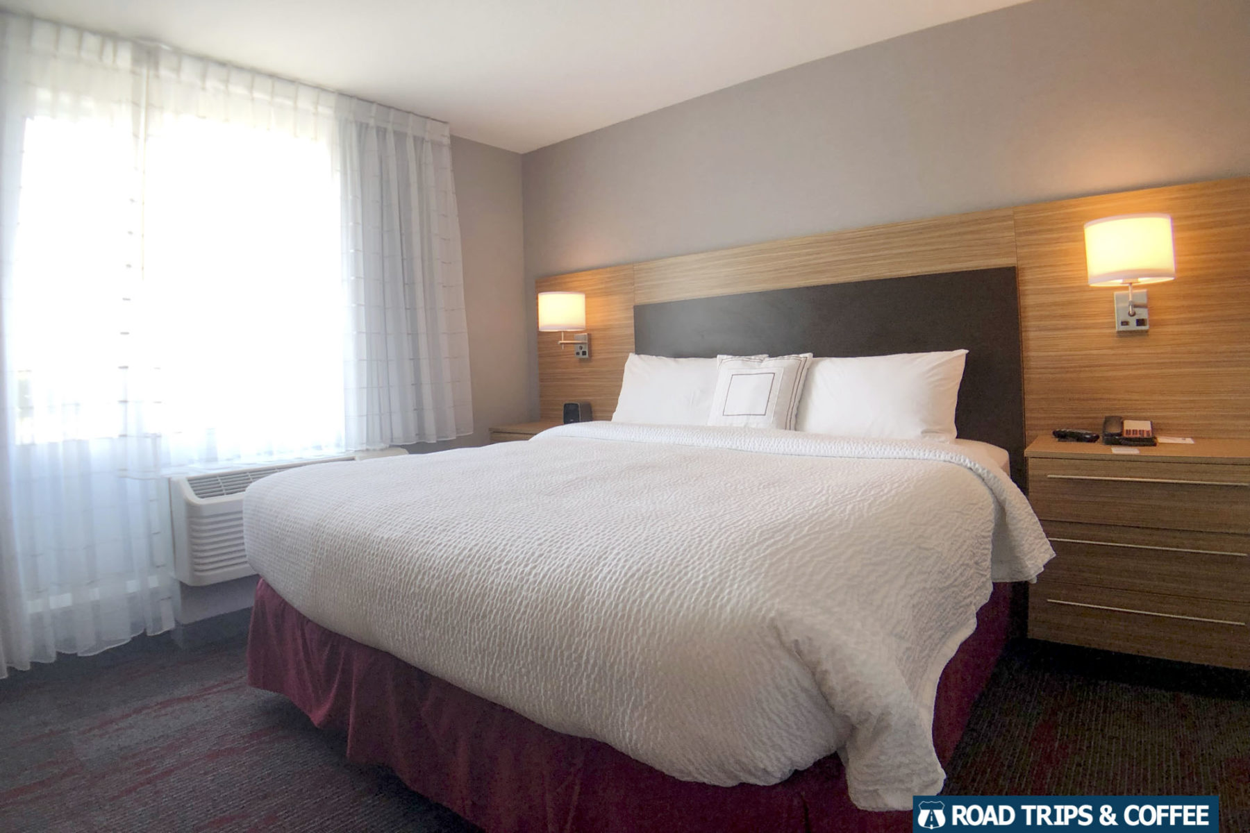A large queen bed in a room at TownePlace Suites by Marriot in Oak Ridge, Tennessee