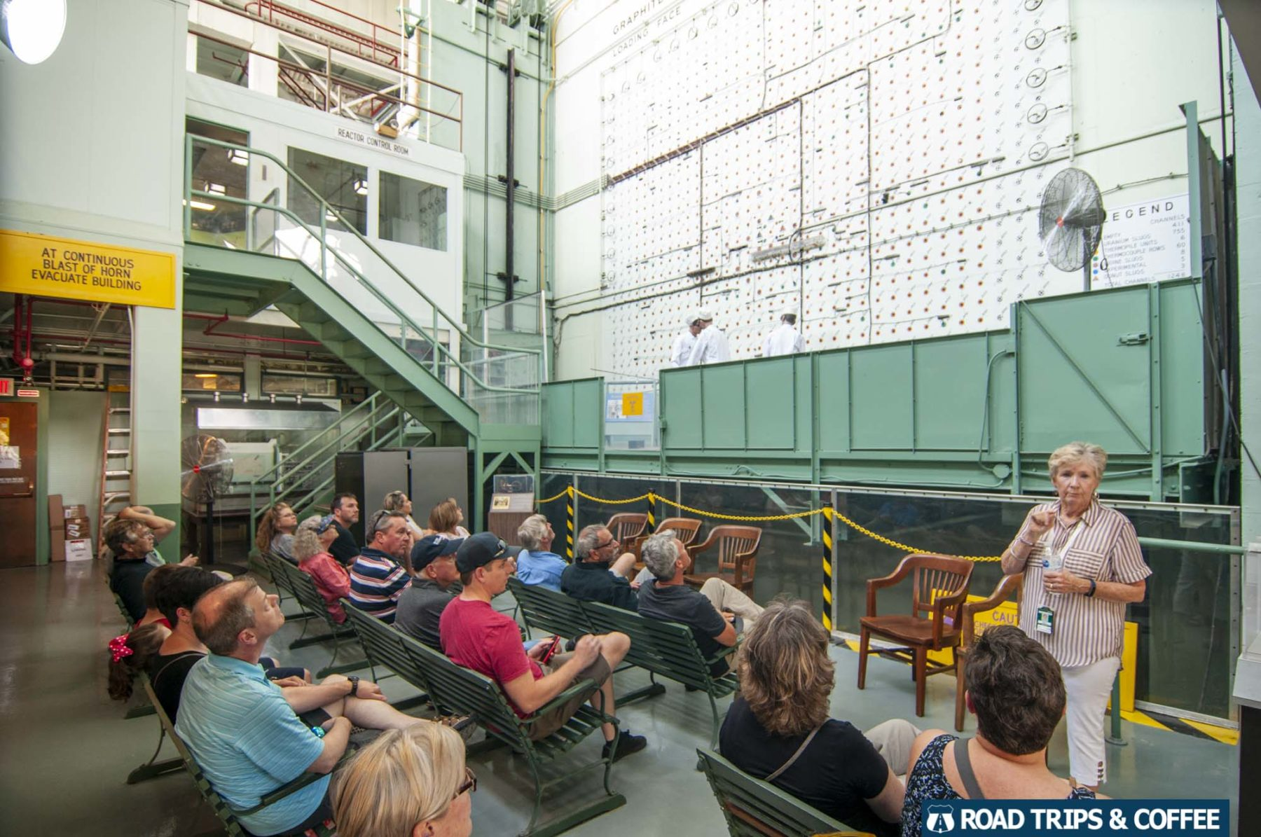 Visitors sit in collapsible chairs inside the enormous X-10 Graphite Reactor in Oak Ridge, Tennessee