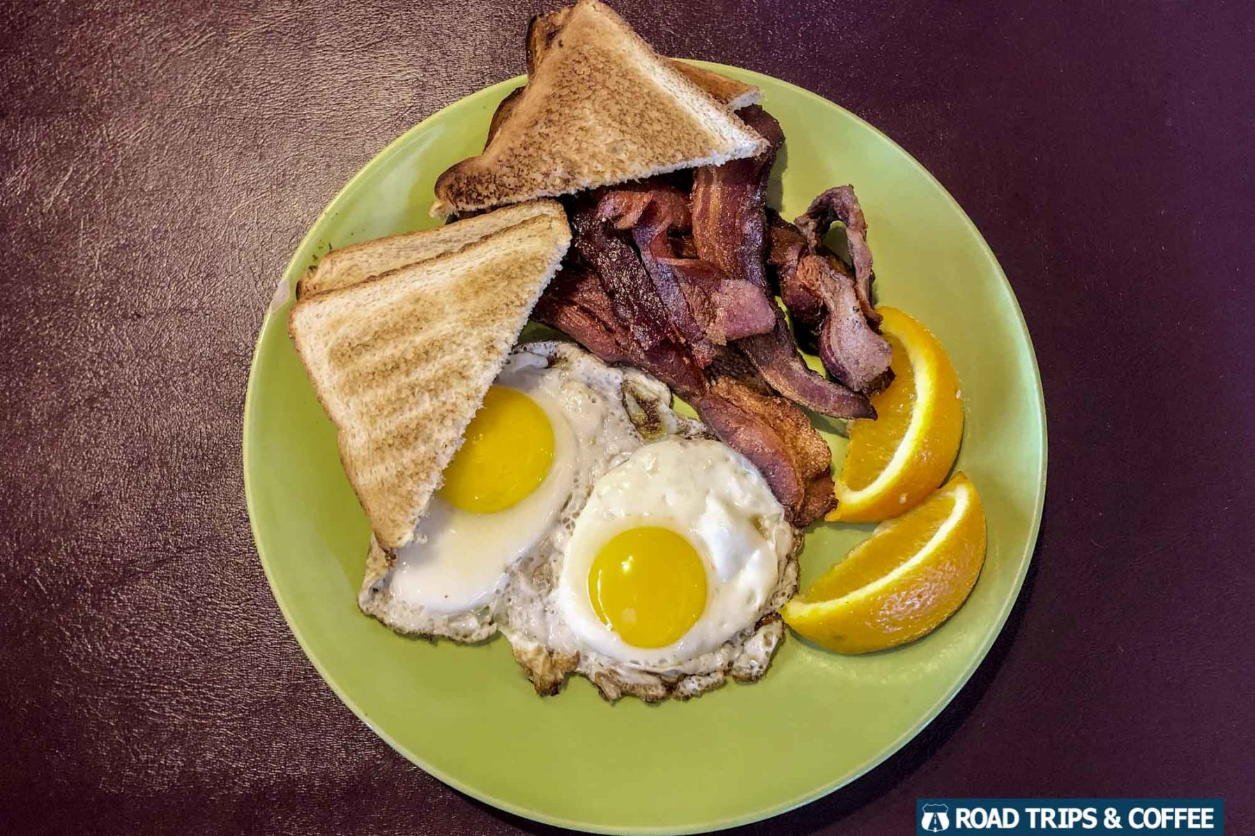 A full breakfast with eggs, bacon, and sausage at Razzleberry's Ice Cream Lab and Kitchen in Oak Ridge, Tennessee