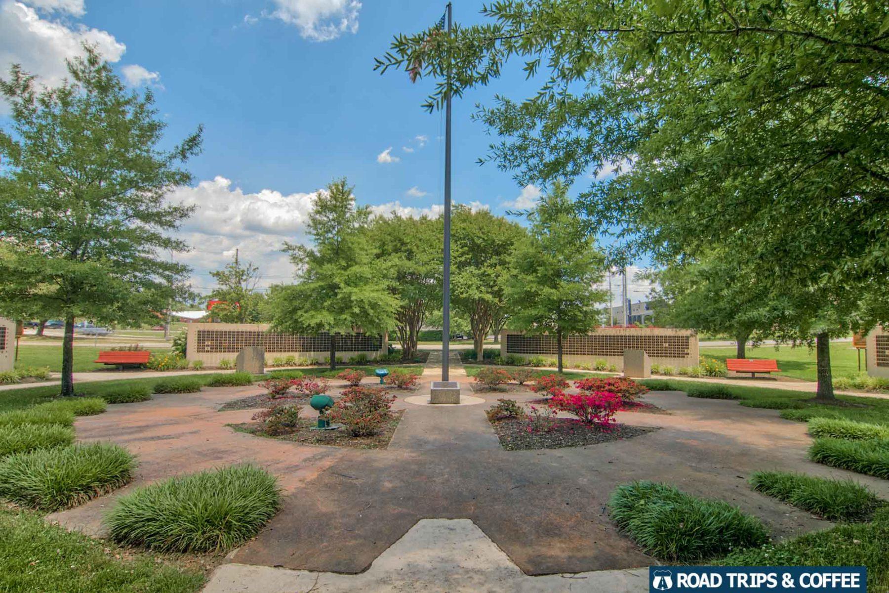 A brick path wraps around a small park at the Secret City Commemorative Walk in Oak Ridge, Tennessee